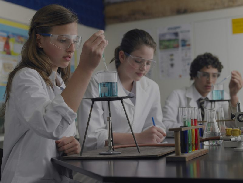 secondary school students doing chemistry experiments